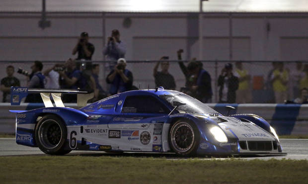 Jorge Goncalvez, of Venezuela, drives the Michael Shank Racing Ford Riley in the Grand-Am Series Rolex 24 hour auto race at Daytona International Speedway, Saturday, Jan. 26, 2013, in Daytona Beach, Fla. (AP Photo/John Raoux)