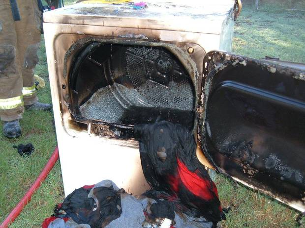 Remains of a dryer and clothes after lint in the dryer ignited.<br/><b>Community Photo By:</b> Jerry Lojka, Fire Marshal<br/><b>Submitted By:</b> Jerry,