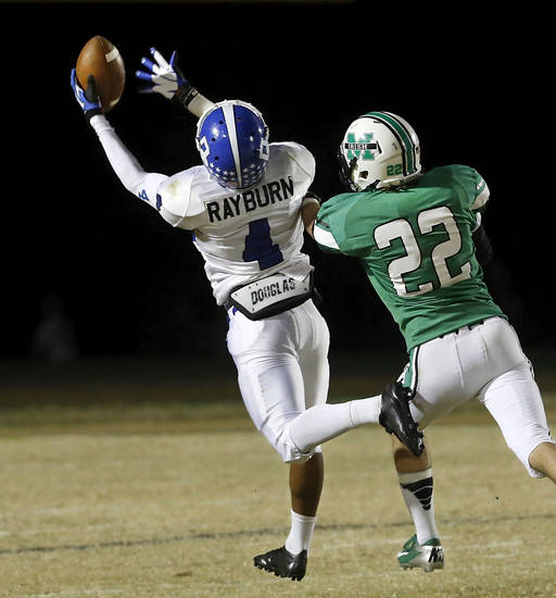 Deer Creek senior wide receiver Jared Rayburn pulls in this long pass in front of McGuinness' Bradley Fritch to set up the Antlers' first touchdown a few plays later in the second quarter.  Deer Creek Antlers vs. Bishop McGuinness Fighting Irish at Pribil Stadium Friday night, Nov. 2, 2012.    Photo by Jim Beckel, The Oklahoman