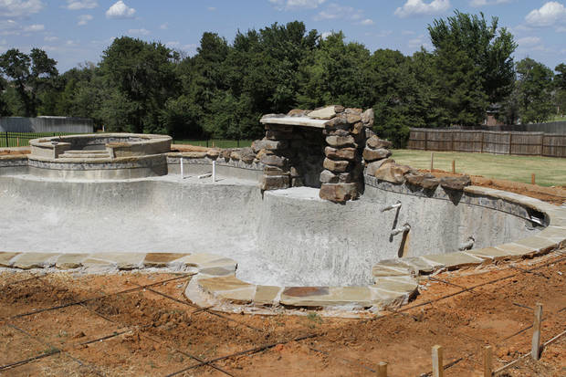 Incomplete features are seen at Jeff and Katherine Hughes' incomplete swimming pool at their home in southeast Oklahoma City. The couple contracted with troubled Lifestyle Pools LLC to build the pool.  <strong>Steve Gooch - The Oklahoman</strong>