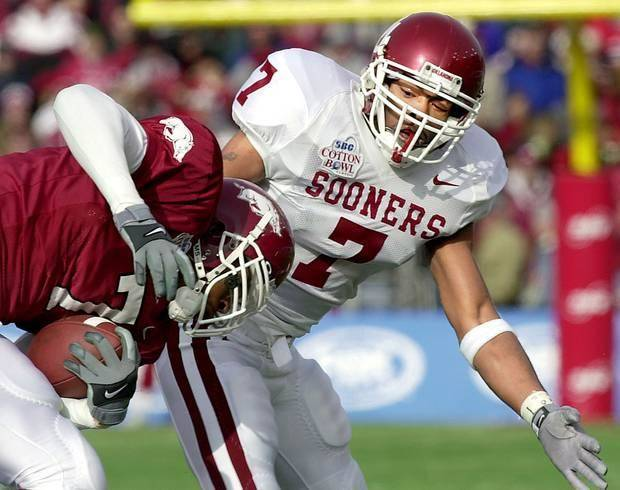 OU safety Brandon Everage drags down Arkansas' Brandon Holmes in the Sooners' 10-3 victory in the Cotton Bowl on Jan. 1, 2002. (Oklahoman archive photo)
