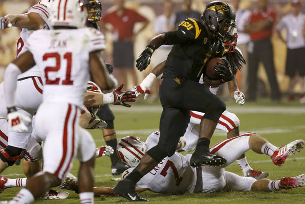 Arizona State's Marion Grice, right, runs past the Wisconsin defense for a touchdown in the second half of an NCAA college football game on Saturday, Sept. 14, 2013, in Phoenix.  Arizona State defeated Wisconsin 32-30. AP Photo/Ross D. Franklin)