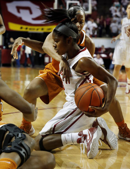 Oklahoma Sooners' Aaryn Ellenberg (3) and Texas Longhorn 's Empress Davenport, back, fight for a loose ball as the University of Oklahoma Sooners (OU) play the University of Texas (UT) Longhorns in NCAA, women's college basketball at The Lloyd Noble Center on Saturday, Jan. 19, 2013 in Norman, Okla. Photo by Steve Sisney, The Oklahoman