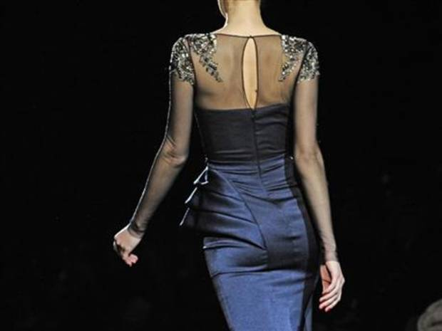 A model wears an outfit in the Badgley Mischka fall 2013 collection in New York City. AP PHOTO