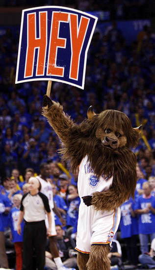 Oklahoma City mascot Rumble the Bison hypes up the crowd during game one of the first round in the NBA playoffs between the Oklahoma City Thunder and the Dallas Mavericks at Chesapeake Energy Arena in Oklahoma City, Saturday, April 28, 2012. Oklahoma City won, 99-98. Photo by Nate Billings, The Oklahoman