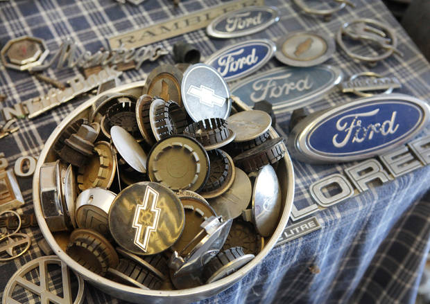 Center caps and emblems at Sandra Mullins' Hubcap World in Oklahoma City, Wednesday, February 13, 2013.   Her father started the business more than 45 years ago.Photo By David McDaniel, The Oklahoman