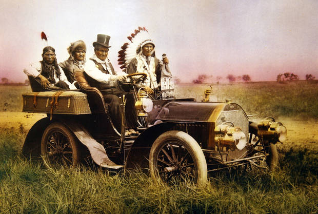 This photo taken at the 101 Ranch shows Geronimo, driver; with Edward Le Clair Sr., next to him; and two other men.PHOTO PROVIDED BY OKLAHOMA HISTORICAL SOCIETY