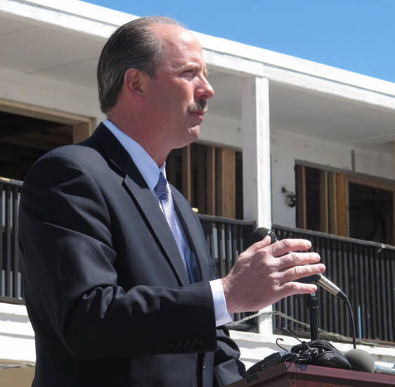 Albuquerque Mayor Richard Berry speaks at the groundbreaking ceremony Thursday April 18, 2013, for the revival project of the Sundowner Motel in Albuquerque, N.M.  The historic Route 66 motor lodge where Bill Gates and Paul Allen launched Microsoft is being redeveloped into apartments as part of a neighborhood revival project. (AP Photo/Russell Contreras)