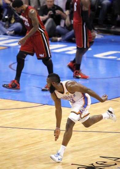 Oklahoma City's James Harden (13) celebrates a three-point shot during Game 1 of the NBA Finals between the Oklahoma City Thunder and the Miami Heat at Chesapeake Energy Arena in Oklahoma City, Tuesday, June 12, 2012. Photo by Sarah Phipps, The Oklahoman
