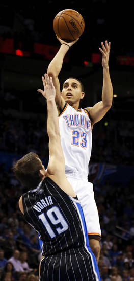 Oklahoma City's Kevin Martin (23) shoots over Orlando's Beno Udrih (19) during an NBA basketball game between the Oklahoma City Thunder and the Orlando Magic at Chesapeake Energy Arena in Oklahoma City, Friday, March 15, 2013. Photo by Nate Billings, The Oklahoman
