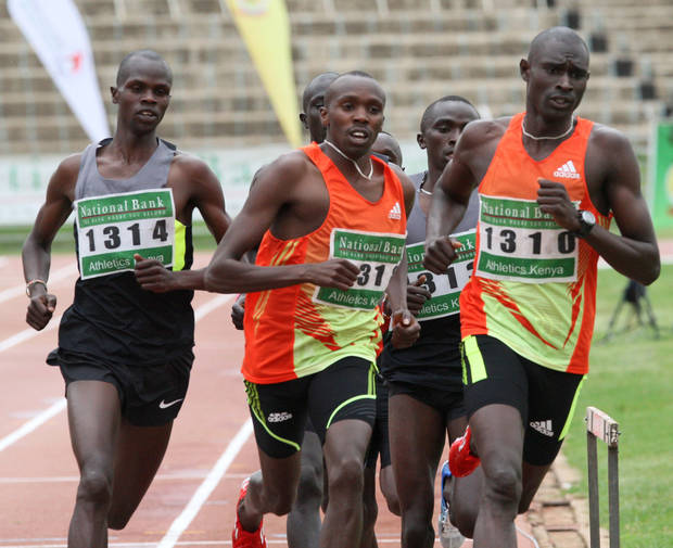 David Lekuta Rudisha, of Kenya , right, leads the pack and went on to win the men's 800 meter semi-final event during national trials for the London 2012 Olympic games at Nyayo National Stadium, Nairobi, Kenya, Thursday, June 21, 2012. (AP Photo/Sayyid Azim)