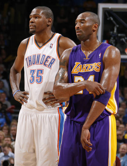 Oklahoma City&#039;s Kevin Durant (35) stands next to Los Angeles&#039; Kobe Bryant (24) during an NBA basketball game between the Oklahoma City Thunder and the Los Angeles Lakers at Chesapeake Energy Arena in Oklahoma City, Thursday, Feb. 23, 2012. Photo by Bryan Terry, The Oklahoman