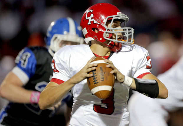 Carl Albert&#039;s Steven Thompson looks to throw a pass during the high school football game between Deer Creek and Carl Albert at Deer Creek High School, Friday, Sept. 21, 2012.  Photo by Sarah Phipps, The Oklahoman