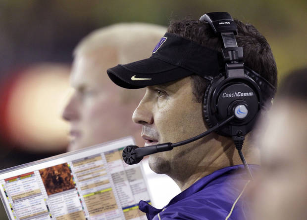 Washington coach Steve Sarkisian watches from the sideline during the first half of an NCAA college football game against Oregon in Eugene, Ore., Saturday, Oct. 6, 2012.(AP Photo/Don Ryan)