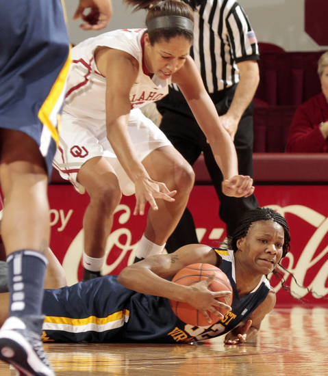West Virginia Mountaineers' Crystal Leary (32) struggles for a rebound in front of Oklahoma Sooner's Nicole Griffin (4) as the University of Oklahoma Sooners (OU) play the West Virginia Mountaineers in NCAA, women's college basketball at The Lloyd Noble Center on Wednesday, Jan. 2, 2013  in Norman, Okla. Photo by Steve Sisney, The Oklahoman