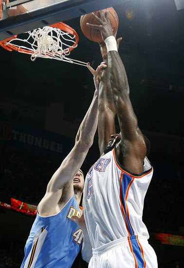 Oklahoma City's Kendrick Perkins (5) shoots over Denver's Kosta Koufos (41) during the NBA preseason basketball game between the Oklahoma City Thunder and the Denver Nuggets at the Chesapeake Energy Arena, Sunday, Oct. 21, 2012. Photo by Sarah Phipps, The Oklahoman