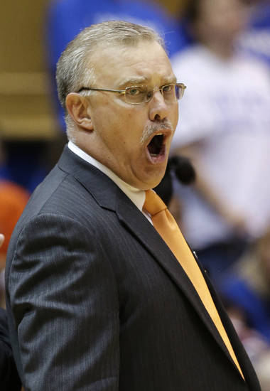 Oklahoma State head coach Jim Littell reacts during the second half of a second-round game against Duke in the women's NCAA college basketball tournament in Durham, N.C., Tuesday, March 26, 2013. Duke won 68-59. (AP Photo/Gerry Broome)