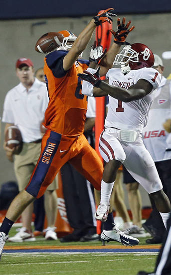 Oklahoma Sooners defensive back Tony Jefferson (1) breaks up a pass for UTEP Miners tight end Eric Tomlinson (87) during the college football game between the University of Oklahoma Sooners (OU) and the University of Texas El Paso Miners (UTEP) at Sun Bowl Stadium on Saturday, Sept. 1, 2012, in El Paso, Tex.  Photo by Chris Landsberger, The Oklahoman