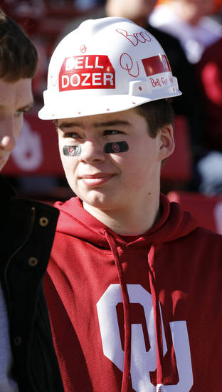 David Callison, 16, from Pryor, wears a hat to support his favorite player Blake Bell during the Bedlam college football game between the University of Oklahoma Sooners (OU) and the Oklahoma State University Cowboys (OSU) at Gaylord Family-Oklahoma Memorial Stadium in Norman, Okla., Saturday, Nov. 24, 2012. Photo by Steve Sisney, The Oklahoman