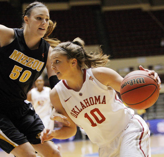 OU's Morgan Hook (10) drives the ball against Missouri's Christine Flores (50) during the Big 12 tournament women's college basketball game between the University of Oklahoma Sooners and the University of Missouri Tigers at Municipal Auditorium in Kansas City, Mo., Thursday, March 8, 2012. Photo by Nate Billings, The Oklahoman