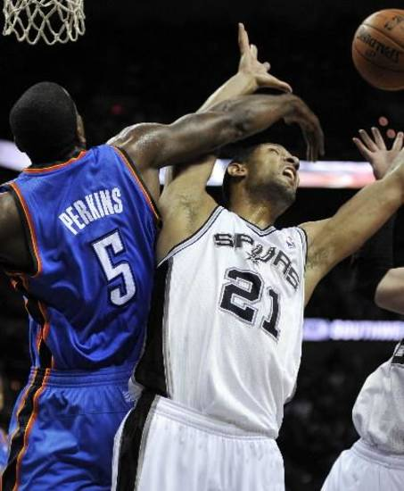Kendrick Perkins, left, battles with San Antonio's Tim Duncan earlier this month.