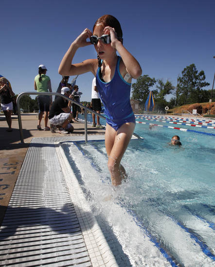 Eight year old Mallory Barrett ends her swimming leg of a youth triathlon hosted by the Edmond YMCA at Hafer Park and Pelican Bay in Edmond, OK, Saturday, July 21, 2012,  By Paul Hellstern, The Oklahoman