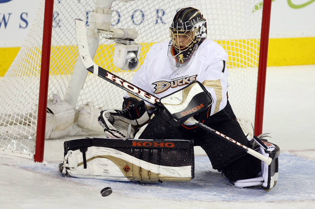 Anaheim Ducks goalie Jonas Hiller, of the Czech Republic, swats away the puck against the Calgary Flames during the second period of their NHL hockey game, Monday, Jan. 21, 2013, in Calgary, Alberta. (AP Photo/The Canadian Press, Jeff McIntosh)