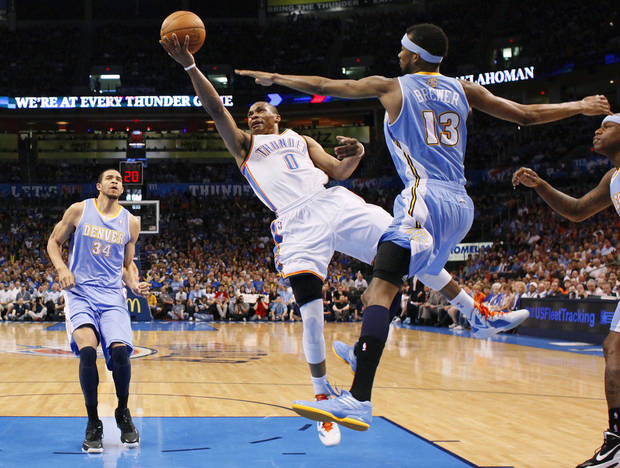 Oklahoma City's Russell Westbrook (0) goes to the basket between Denver's JaVale McGee (34) and Corey Brewer (13) during the NBA basketball game between the Oklahoma City Thunder and the Denver Nuggets at Chesapeake Energy Arena in Oklahoma City, Wednesday, April 25, 2012. Oklahoma City lost 106-101.  Photo by Bryan Terry, The Oklahoman
