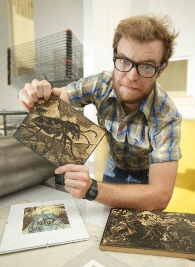 University of Oklahoma student Thomas Shahan, 22, shows off some of his wood block prints at the art school on Aug. 23. Shahan says carving wood blocks is similar to his other passion, photographing insects. Both involve focus, patience and attention to detail. Photo by Steve Sisney, The Oklahoman <strong>STEVE SISNEY</strong>