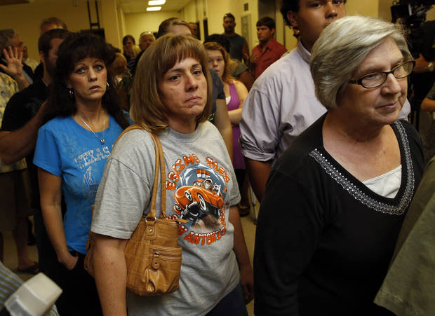 CHRISTOPHER LANE MURDER: People crowd the hall as they wait to enter the courtroom as three teenage suspects are arraigned in the shooting death of Christopher Lane on Tuesday, Aug. 20, 2013 in Duncan, Okla.  Photo by Steve Sisney, The Oklahoman