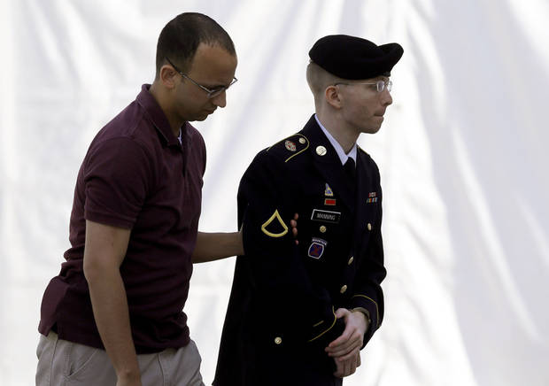 Army Pfc. Bradley Manning, right, is escorted into a courthouse in Fort Meade, Md., Wednesday, June 5, 2013, on the third day of his court martial. Manning is charged with indirectly aiding the enemy by sending troves of classified material to WikiLeaks. He faces up to life in prison. (AP Photo/Patrick Semansky)