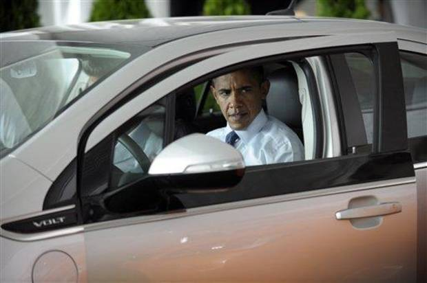 President Barack Obama sits in a Chevy Volt, Thursday, July  15, 2010, during a groundbreaking ceremony at Compact Power, Inc., a subsidary of LG Chem Ltd., a battery plant in Holland, Mich. (AP Photo/Susan Walsh)