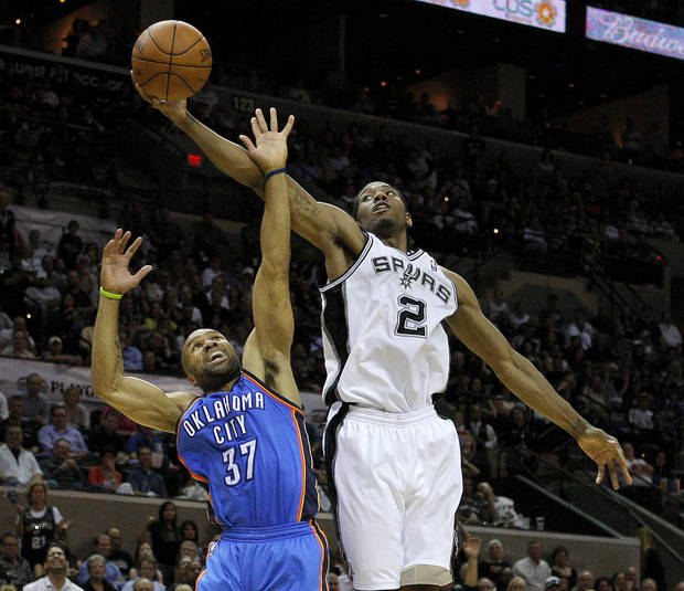 San Antonio's Kawhi Leonard (2) grabs the ball over Oklahoma City's Derek Fisher (37)  during Game 2 of the Western Conference Finals between the Oklahoma City Thunder and the San Antonio Spurs in the NBA playoffs at the AT&T Center in San Antonio, Texas, Tuesday, May 29, 2012. Photo by Bryan Terry, The Oklahoman
