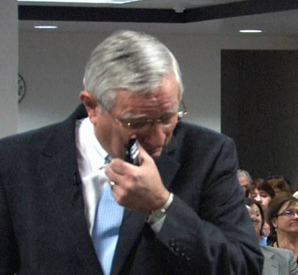 In this screen grab from a DHS recording, DHS Director Howard Hendrick wipes away tears Tuesday after announcing his retirement.  <strong></strong>