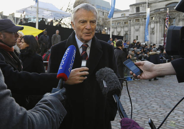Max Mosley, ex-Formula One boss speaks to the media outside the Queen Elizabeth II Conference Center in London, where Lord Justice Brian Leveson released his report, after a year long inquiry, into the culture and practices of the British press and his recommendations for future regulation to prevent phone hacking, data theft, bribery and other abuses,  Thursday, Nov. 29, 2012. (AP Photo/Kirsty Wigglesworth)