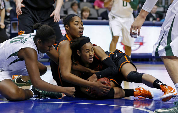 Baylor's Destiny Williams (10) fights with Oklahoma State's Tiffany Bias (3), at right, and LaShawn Jones (55) for the ball during the Big 12 tournament women's college basketball game between Oklahoma State University and Baylor at American Airlines Arena in Dallas, Sunday, March 10, 2012.  Photo by Bryan Terry, The Oklahoman