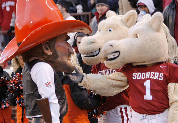 OU mascots Boomer and Sooner, right, joke with OSU mascot Pistol Pete during the second half of the Bedlam college football game between the University of Oklahoma Sooners and the Oklahoma State University Cowboys at the Gaylord Family -- Oklahoma Memorial Stadium on Saturday, Nov. 24, 2007, in Norman, Okla.   Photo by Nate Billings, The Oklahoman