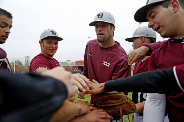 HIGH SCHOOL BASEBALL: Capitol Hill baseball coach Mike Hinckley, center,  huddles with Jorge Hernandez, left, Tyler Moore, Juan Del Moral, and Richard Riley before a game in Oklahoma City, Tuesday, April 16, 2013. Photo by Bryan Terry, The Oklahoman