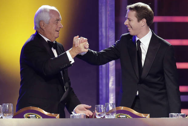 Team owner Roger Penske, left, greets Brad Keselowski at the start of the season-ending NASCAR awards ceremony, Friday, Nov. 30, 2012, in Las Vegas. Keselowski won the Sprint Cup title this year. (AP Photo/Julie Jacobson)