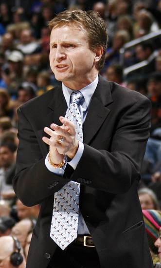 Oklahoma City head coach Scott Brooks encourages his team during the NBA basketball game between the Golden State Warriors and the Oklahoma City Thunder at the Ford Center in Oklahoma City, Monday, December 8, 2008. BY NATE BILLINGS, THE OKLAHOMAN