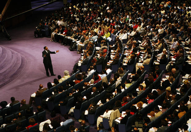 "In this Sunday, Nov. 11, 2007 photo, Rev. Creflo Dollar delivers his second sermon of the day at World Changers Church International, in College Park, Ga. Dollar has been arrested after authorities say he slightly hurt his 15-year-old daughter in a fight at his metro Atlanta home. Fayette County Sheriff's Office investigator Brent Rowan says deputies responded to a call of domestic violence at the home around 1 a.m. Friday, June 8, 2012. Rowan says the 50-year-old pastor and his daughter were arguing over whether she could go to a party when Dollar ""got physical"" with her, leaving her with ""superficial injuries."" (AP Photo/Atlanta Journal-Constitution, Pouya Dianat) MARIETTA DAILY OUT; GWINNETT DAILY POST OUT; LOCAL TV OUT; WXIA-TV OUT; WGCL-TV OUT"