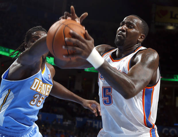 Oklahoma City's Kendrick Perkins (5) fights Denver's Kenneth Faried (35) for a loose ball during the NBA preseason basketball game between the Oklahoma City Thunder and the Denver Nuggets at the Chesapeake Energy Arena, Sunday, Oct. 21, 2012. Photo by Sarah Phipps, The Oklahoman