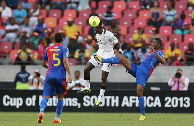 "Ghana's John Boye, center, heads the ball as he defends against Cape Verde's Fernando Varela, right, and teammate Babanco"" Macedo, left, during their quarter final of the African Cup of Nations  soccer match at the Nelson Mandela Bay Stadium in Port Elizabeth, South Africa, Saturday Feb. 2, 2013. (AP Photo/Themba Hadebe)"