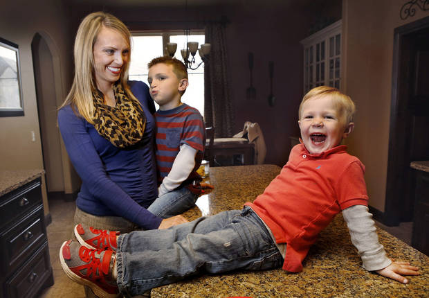 Drake Stallings, 2, has hemophilia, unlike anyone else in his family, including his 5-year-old brother Talen and his mother Beth Stallings. Photo by Jim Beckel, The Oklahoman