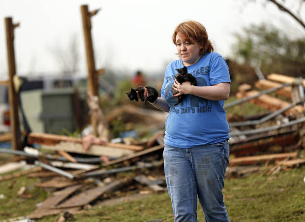 Rachel Hilton holds stray kittens she found in the debris of her parents' home at SW 149th and Stone Meadows Dr. after a tornado struck south Oklahoma City and Moore, Okla., Monday, May 20, 2013. (AP Photo/The Oklahoman, Nate Billings) ORG XMIT: OKOKL419