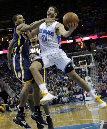 New Orleans point guard Greivis Vasquez (21) shoots over the defense of Indiana point guard George Hill (3) in the second half of a NBA basketball game at the New Orleans Arena in New Orleans Saturday, Dec. 22, 2012. Indiana beat New Orleans 81-75. (AP Photo/Dave Martin)