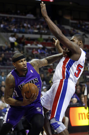 Sacramento Kings center DeMarcus Cousins (15) shoves Detroit Pistons forward Jason Maxiell (54) as he drives to the basket in the first half of an NBA basketball game Tuesday, Jan. 1, 2013, in Auburn Hills, Mich. (AP Photo/Duane Burleson)