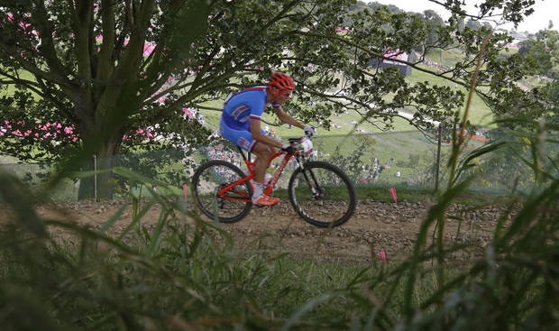 Gold medalist Jaroslav Kulhav, of the Czech Republic, competes in the Mountain Bike Cycling men's race, at the 2012 Summer Olympics, Sunday, Aug. 12, 2012, at Hadleigh Farm, in Essex, England. (AP Photo/Sergey Ponomarev)