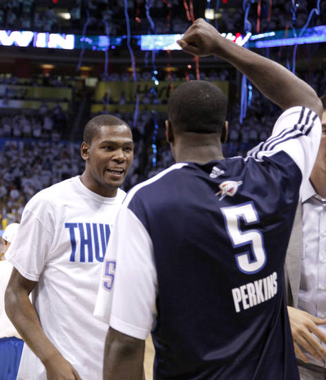 Oklahoma City's Kevin Durant (35) and  Kendrick Perkins (5) celebrate following game five of the Western Conference semifinals between the Memphis Grizzlies and the Oklahoma City Thunder in the NBA basketball playoffs at Oklahoma City Arena in Oklahoma City, Wednesday, May 11, 2011. Photo by Sarah Phipps, The Oklahoman