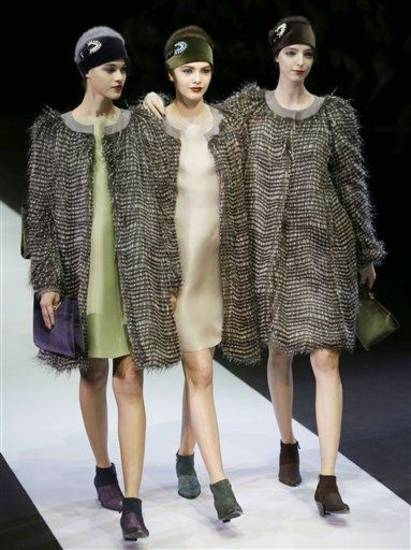 Models wear creations for Emporio Armani women&#039;s Fall-Winter 2013-14 collection, part of the Milan Fashion Week, unveiled in Milan, Italy, Sunday, Feb. 24, 2013. (AP Photo/Luca Bruno)